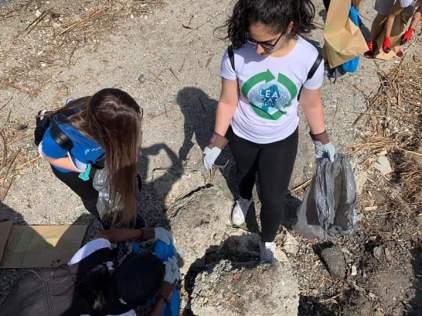volunteers cleaning Su Siccu