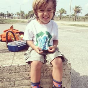 Amos, the youngest volunteer at the beach cleanup
